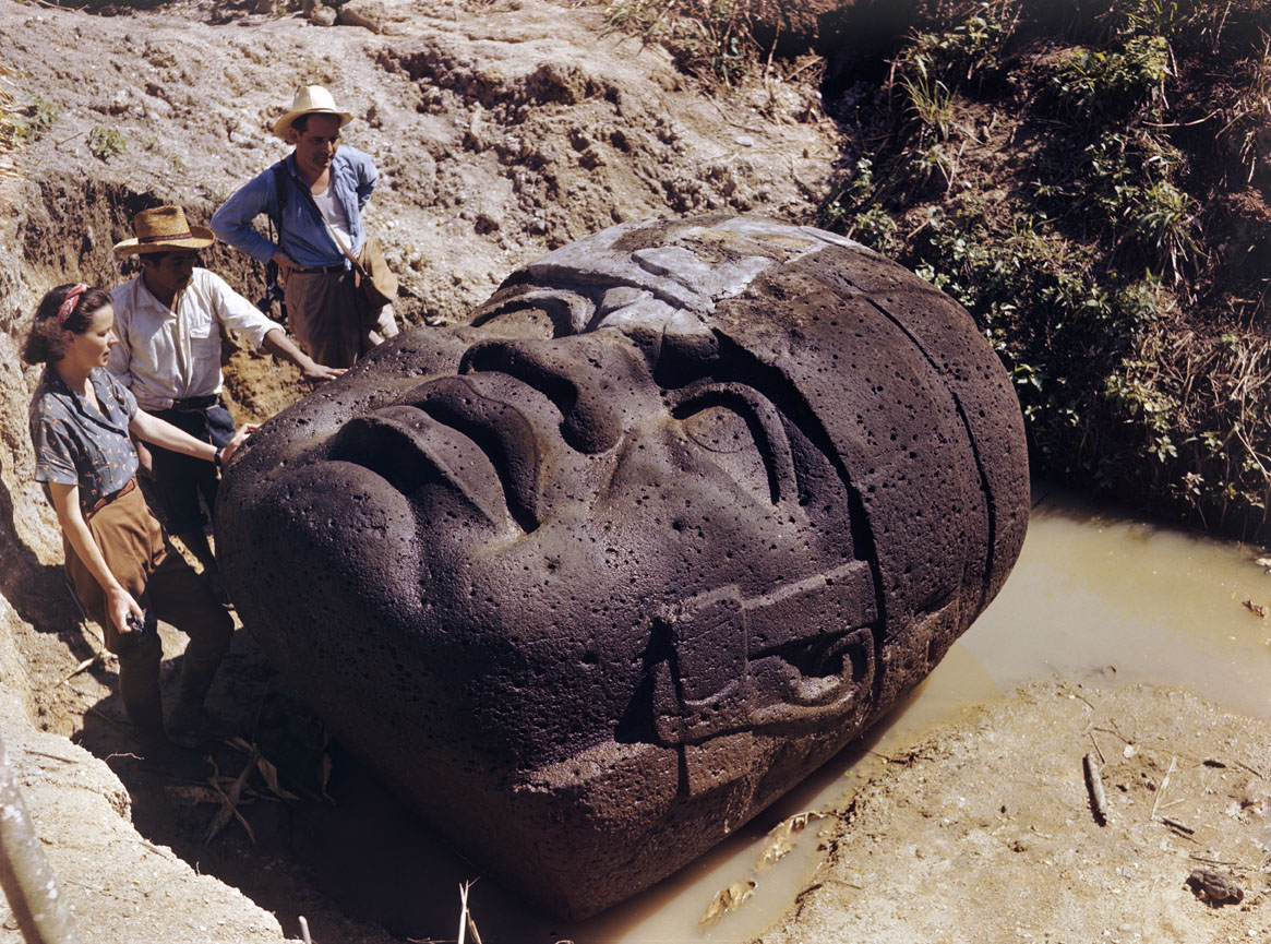 Archaeologists and Olmec head