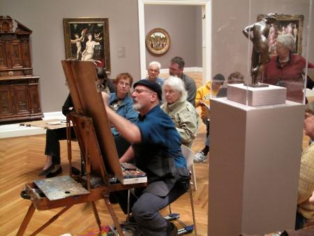 Professor Rick Rodrigues instructs his students in a de Young Gallery