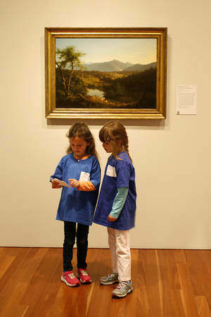 Two Apprentices on a scavenger hunt in the de Young galleries