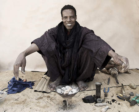 Koumama shows off his traditional Tuareg jewelry