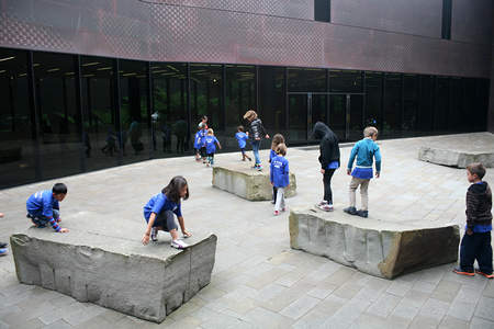 Summer Art Campers trace the path of Andy Goldsworthy's Drawn Stone on foot