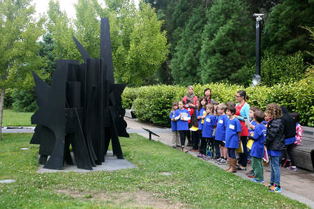 Art campers observe a Louise Nevelson sculpture outside in the sculpture garden