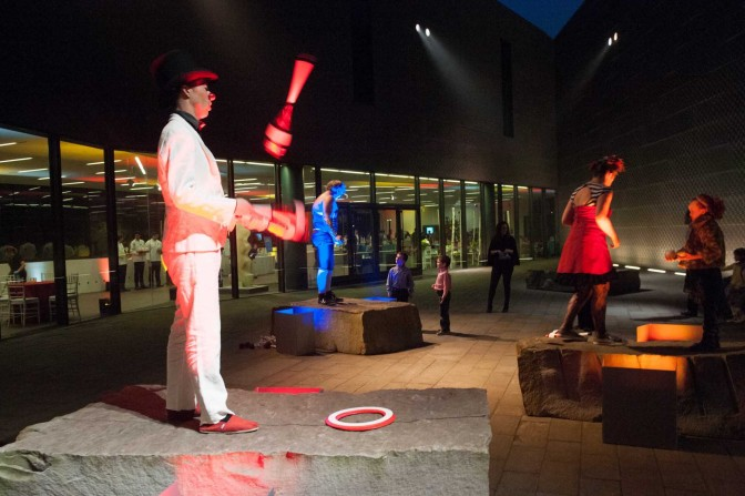 Jugglers performing on top of Andy Goldsworthy's Drawn Stone in Diller Court