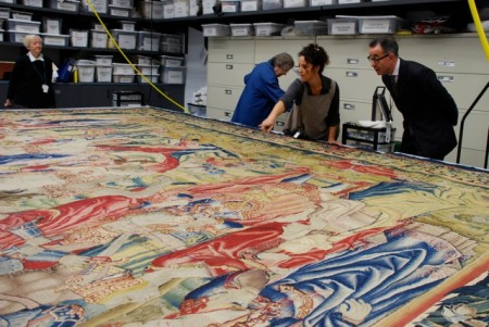 Director Colin B. Bailey and textile conservator review the monumental tapestry