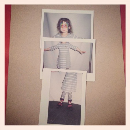 A little girl is pictured as a composite of three polaroids illustrating the top, middle, and bottom portions of her body