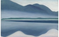 Painting of mountains mirrored in lake