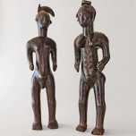Male and female divination figures representing high-ranking individuals, 19th century. Côte d'Ivoire, Guro. Wood and fiber. Richard H. Scheller Collection. Photo © Robert A. Kato