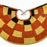 'Ahu 'ula (cape), possibly late 18th–early 19th century. Red 'i'iwi (Vestiaria coccinea) feathers, yellow and black 'ō'ō (Moho sp.) feathers, and olonā (Touchardia latifolia) fiber. Bernice Pauahi Bishop Museum, Ethnology Collection, C.00208/1927.073. Photograph by Hal Lum and Masayo Suzuki