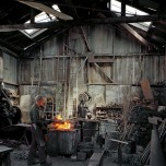 Janet Delaney, Johnny Ryan, Blacksmith, Klockar's Blacksmith and Metal Works, 443 Folsom Street, 1980. Archival pigment print. Image courtesy of the artist. © 2014 Janet Delaney