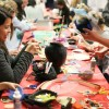 Museum visitors make art on a Friday Night at the de Young