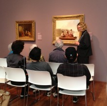 Docent in the galleries with seated guests
