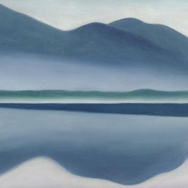 painting of mountains reflected in water