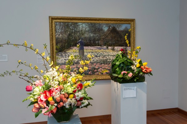 George Hitchcock, Tulip Culture, 1889. Oil on canvas. FAMSF, Collection of Diane B. Wilsey, L10.66. Floral design by Judy Cochran Ward. Photograph © Greg A. Lato / latoga photography