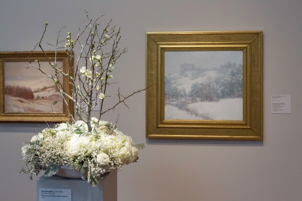 Willard Leroy Metcalf, Winter's Festival, 1913. Oil on canvas. FAMSF, gift of Mrs. Herbert Fleishhacker, 47.5.3. Floral design by Dariel Alexander. Photograph © Greg A. Lato / latoga photography