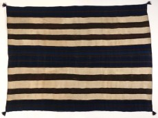 A dark woven background with six cream colored horizontal stripes.