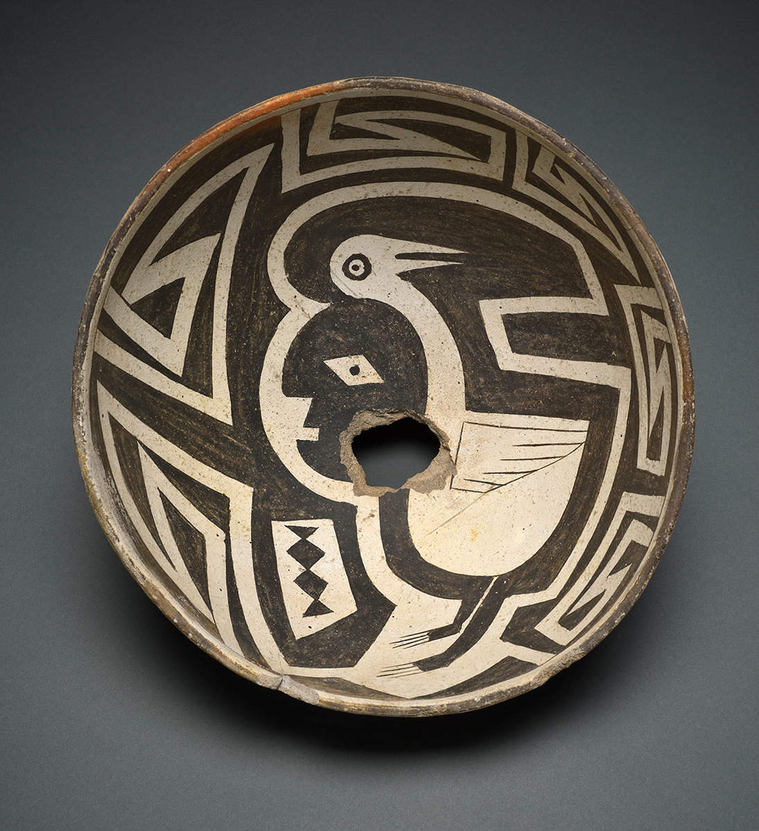 Bowl with human-avian figure. Mimbres artist, New Mexico, United States, ca. 1000–1150. Earthenware and pigment. Diameter: 9 3/4 in. (24.7 cm). Fine Arts Museums of San Francisco, Gift of the Thomas W. Weisel Family, 2013.76.99