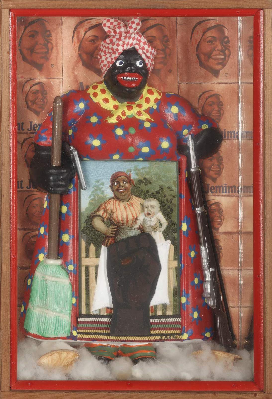 "Betye Saar, ""The Liberation of Aunt Jemima,"" 1972. Wood, cotton, plastic, metal, acrylic paint, printed paper and fabric,  11.375 x 8 in. (29.8 x 20.3 cm). Collection of Berkeley Art Museum and Pacific Film Archive, Berkeley, California; purchased with the aid of funds from the National Endowment for the Arts (selected by The Committee for the Acquisition of Afro-American Art). Courtesy of the artist and Roberts Projects, Los Angeles, California. Photo Benjamin Blackwell"