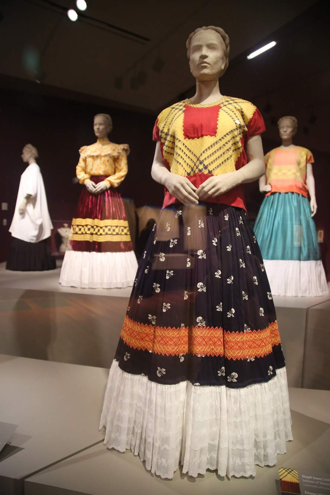 """Installation of """"Frida Kahlo: Appearances Can Be Deceiving"""" at the de Young museum, with Kahlo's ensembles from the Museo Frida Kahlo."""
