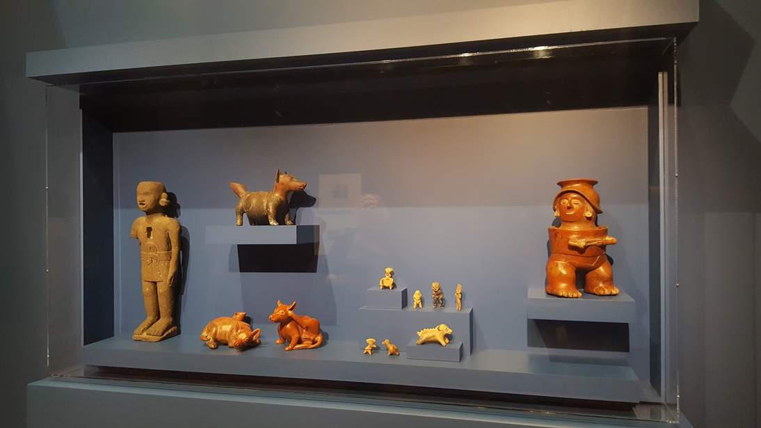 """Installation of """"Frida Kahlo: Appearances Can Be Deceiving"""" at the de Young museum , showing a selection of pre-Hispanic objects from the collection of the Fine Arts Museums of San Francisco."""
