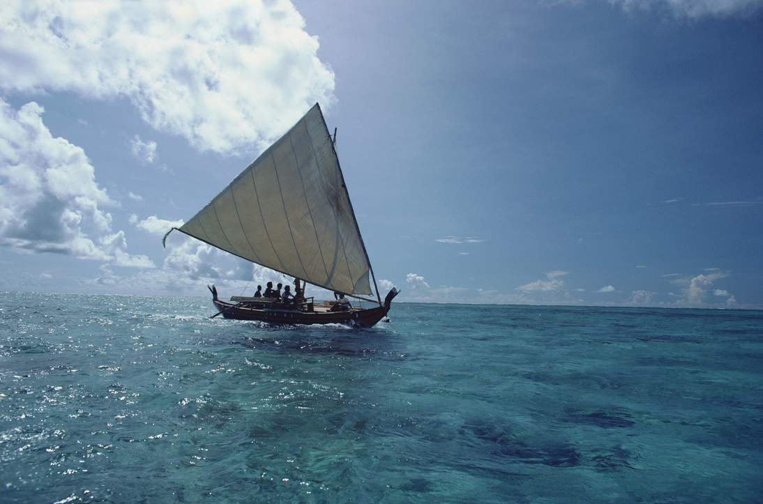 Traditional sailing canoe under full sail. Yap, Caroline Islands, Micronesia