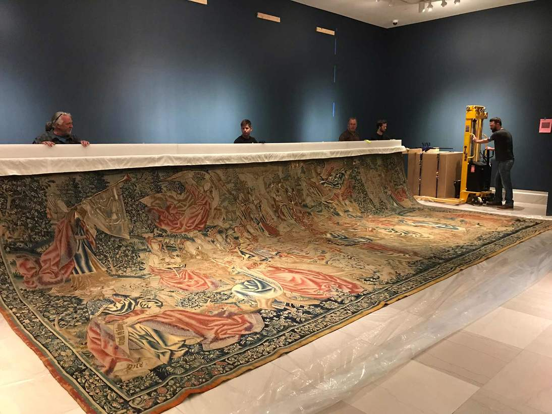 Once the tapestry was aligned and carefully attached using the Velcro strips, the batten was raised.