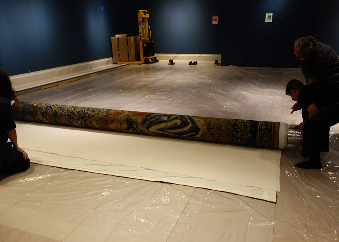 """""""The Combat of the Vices and Virtues"""" tapestry was slowly unrolled in the exhibition galleries."""
