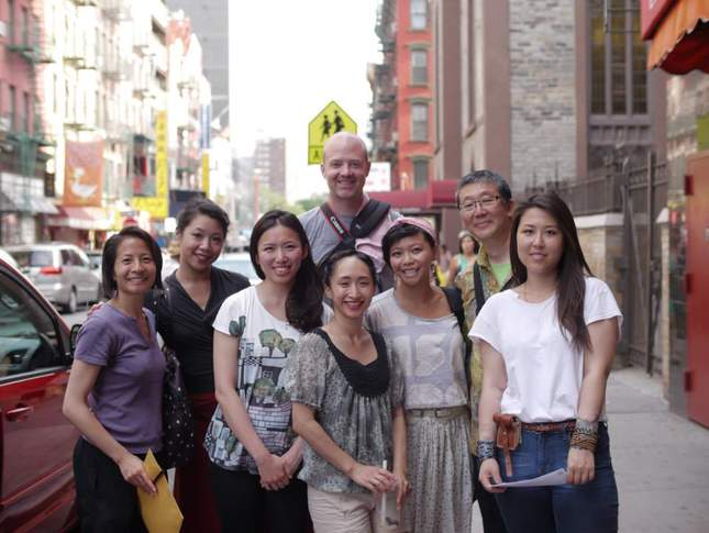 A group photo of Lenora Lee and her many collaborators on the streets of NYC