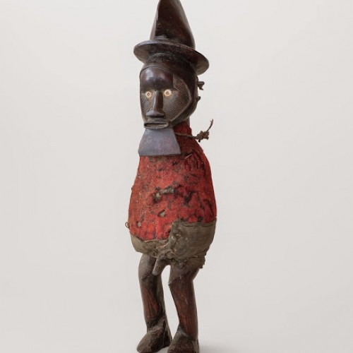 Mpungu, power figure, 20th century. Republic of the Congo, Teke. Wood, fiber, shell, metal, and dye. Richard H. Scheller Collection. Photo © Robert A. Kato