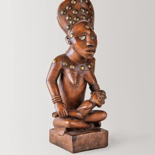 Maternity figure, late 19th-early 20th century. Democratic Republic of the Congo, Kongo,. Wood, copper alloy, and glass. Richard H. Scheller Collection. Photo © Robert A. Kato