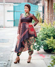 Naima Muhammad (b. United States, 1973) for House of Coqueta (est. United States, 2010), Ensemble: Asymmetric tunic, gathered ankle pants, headwrap, and bandana neck scarf, Yar Hawwa Collection, 2017, printed Ghanian cotton-and-polyester blend. Courtesy of the artist.