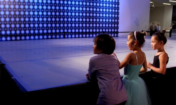 Eager young visitors wait for the performance to begin in Wilsey Court during Friday Nights at the de Young museum