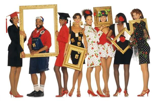 Patrick Kelly and models posing with gold picture frames