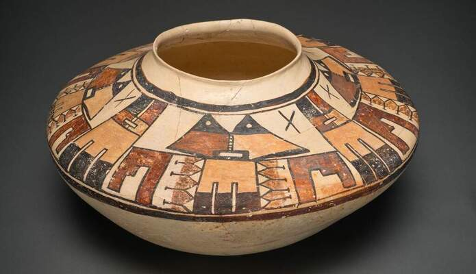 A bowl with triangle and rectangular shapes in various shades of brown.