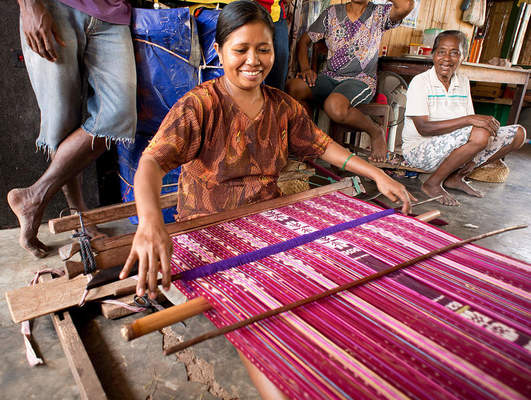 Weaver from the island of Lembata, Indonesia, weaving a cloth for a sarong with ikat decoration, using a body-tensioned loom.
