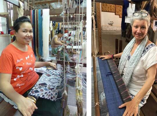 Ms. Boua and speaker Carol Cassidy at their looms