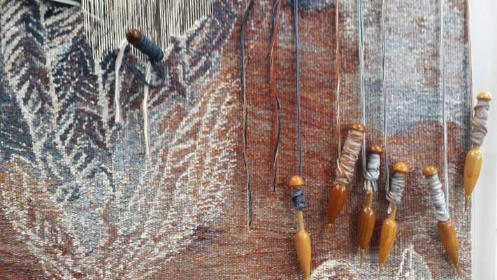 """On the loom: Valerie Kirk's """"Floating Fossil Tapestry"""" being woven."""